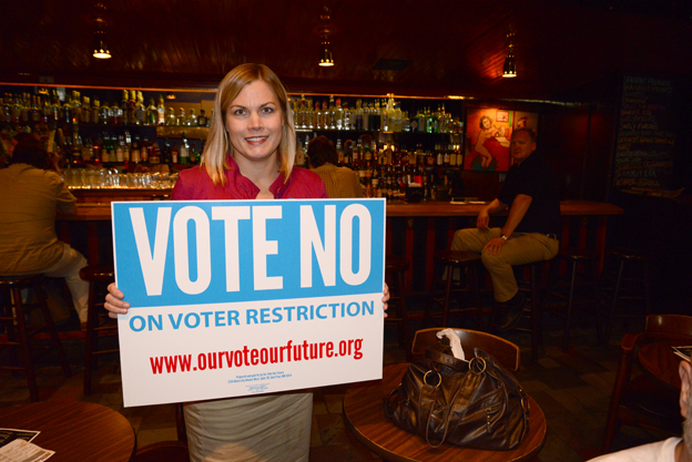 Greta Bergstrom with Vote No sign