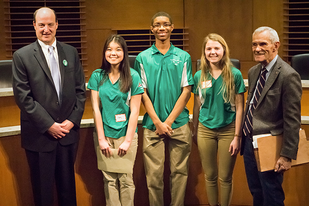 "Rep. Paul Rosenthal, Rep. Ron Erhardt and members of the Edina High School robotics team, ""The Green Machine"" 