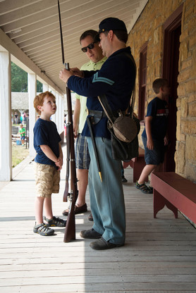 A civil war soldier (on Civil War weekend a few years ago) talks to an obviously mesmerized young boy.